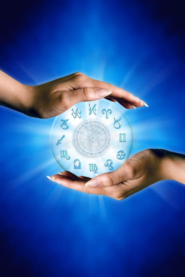 Woman hands with zodiac symbols and horoscope like astrology concept over blue background royalty free stock image