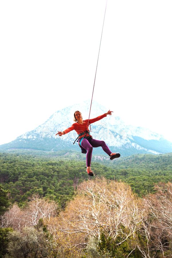 A woman is hanging on a rope. royalty free stock photos