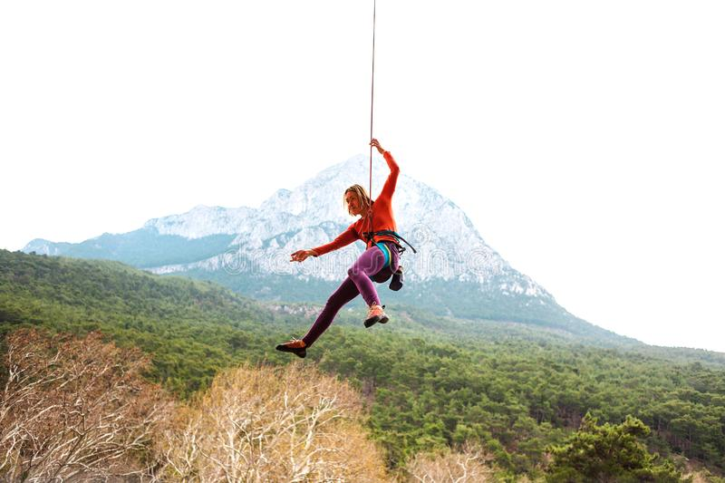 A woman is hanging on a rope. royalty free stock image