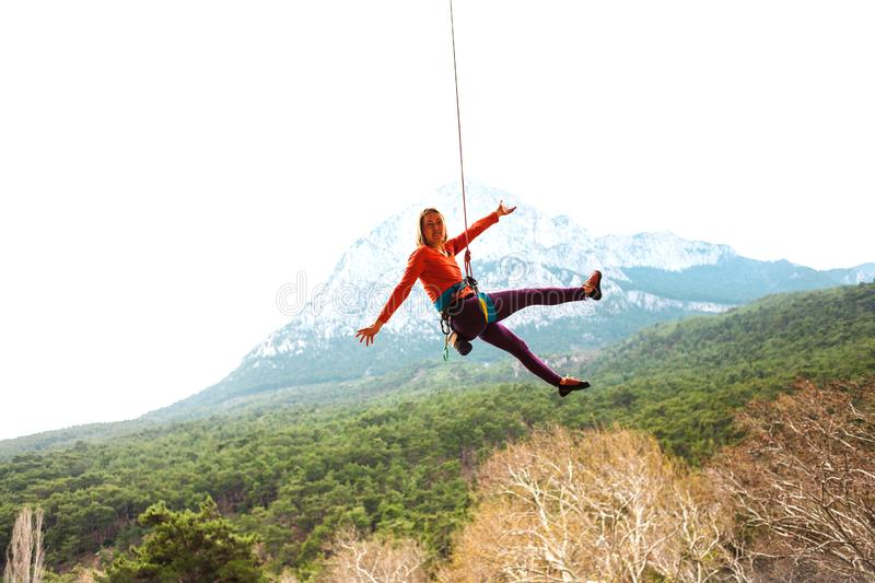 A woman is hanging on a rope. royalty free stock photography