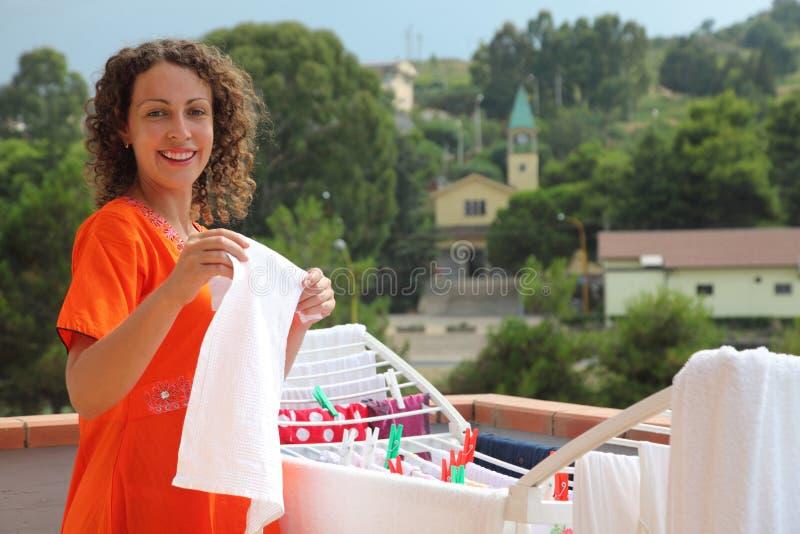 Download Woman Hangs Clean Wear On Balcony Stock Photo - Image: 17035468