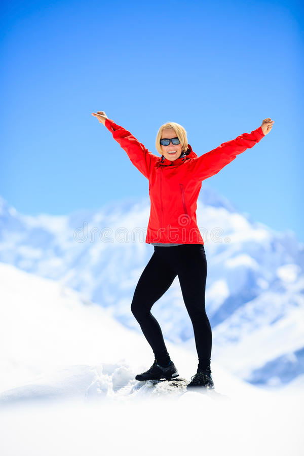 Woman happiness portrait on mountain peak stock images