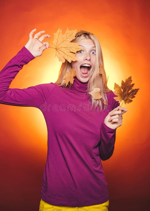 Woman happy autumn in autumn park. Autumn discounts on lingerie. Sale of womens panties. Leaf fall. Happy young woman royalty free stock photo