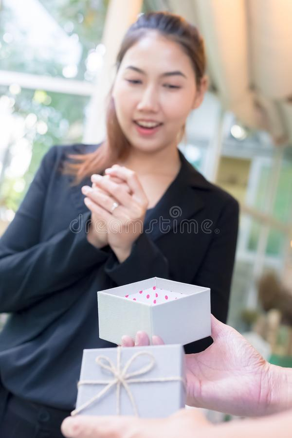 A women happy  with gift box from a man. A woman happy  with gift box royalty free stock photo