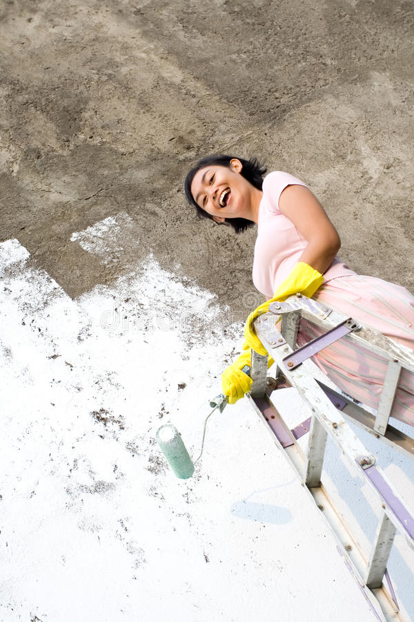 Woman happy with painting job royalty free stock photography
