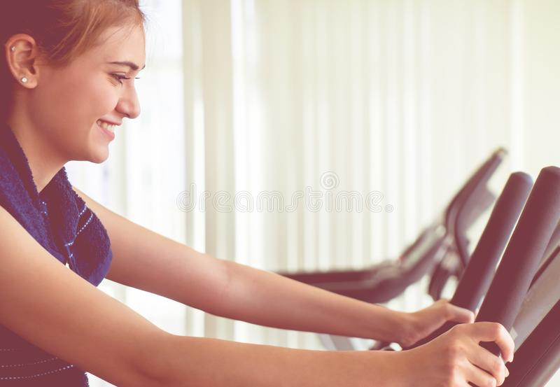 Woman is happy with the result of her fitness work out royalty free stock image