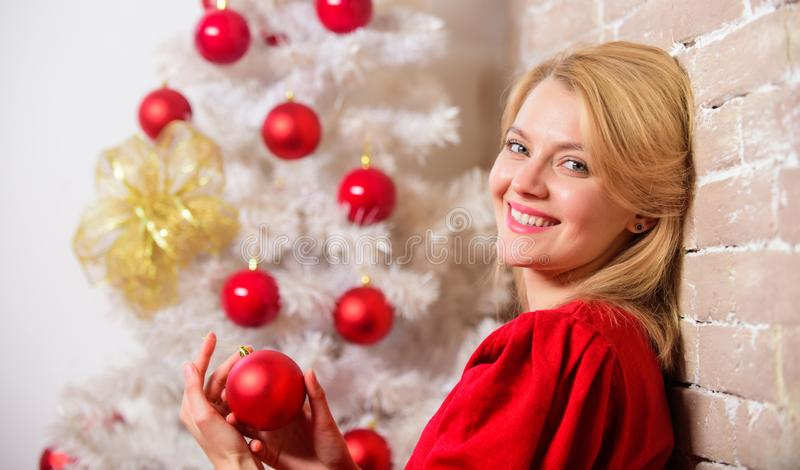 Woman happy smiling near christmas tree. Christmas eve concept. Girl in red dress near christmas tree with ornaments royalty free stock photography