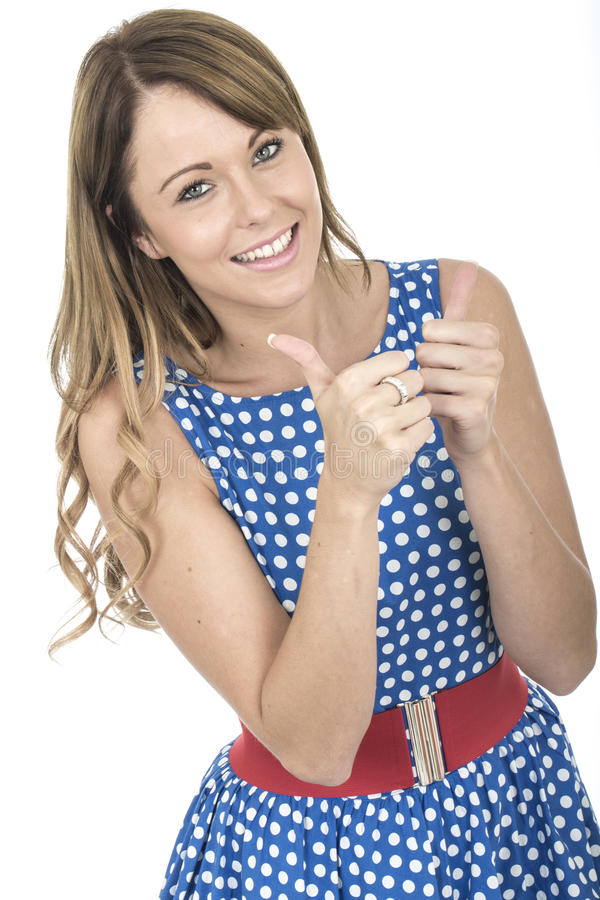 Woman Happy Wearing Blue Polka Dot Dress Thumbs Up. Young Woman Happy Wearing Blue Polka Dot Dress Thumbs Up royalty free stock photography
