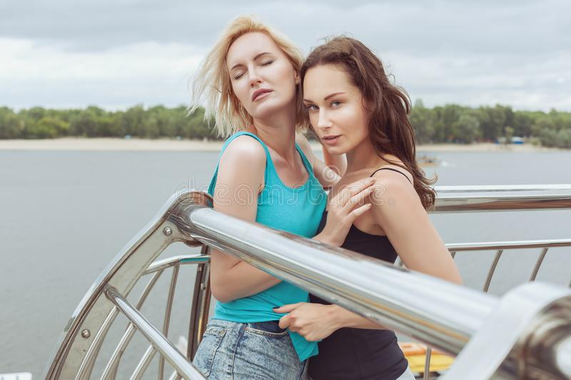 Woman is harassing a woman. Woman solicits a woman, she is in love with her stock image