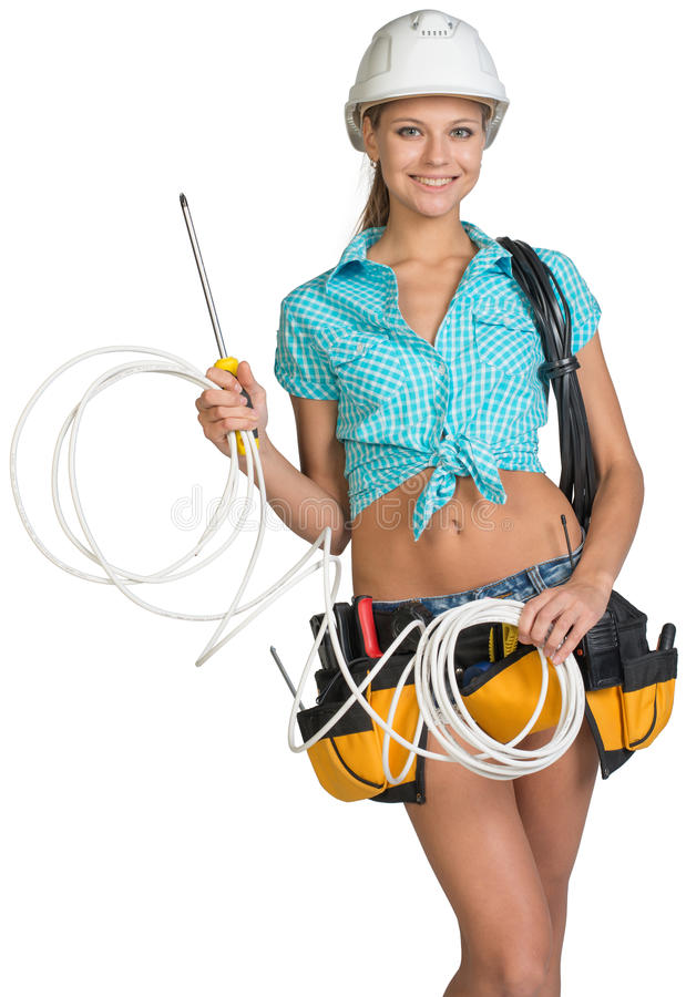 Woman in hard hat and tool belt holding coil of royalty free stock image