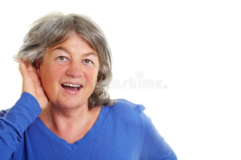 Woman with hardness of hearing. Elderly woman with hardness of hearing listening royalty free stock photo