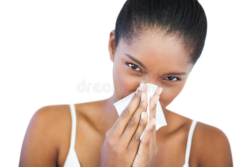 Woman has a cold. On white background royalty free stock photography