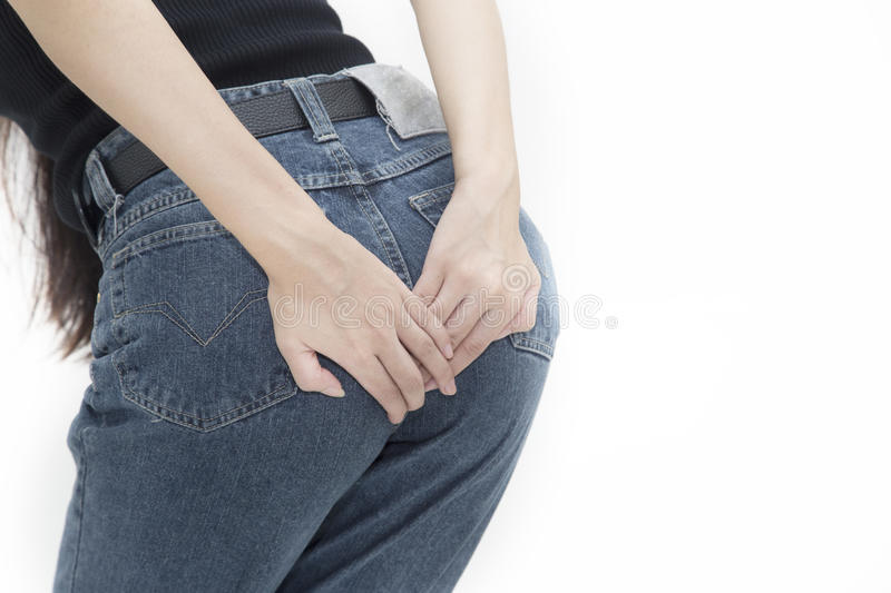 Woman has diarrhea holding her. Bum, pain in the butt, isolated on white background stock photo