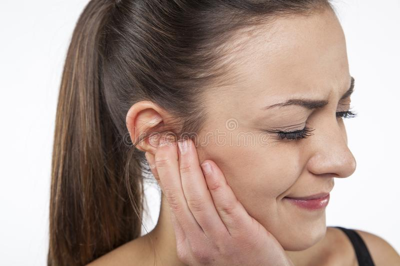Woman has a ear pain. On white background stock photo