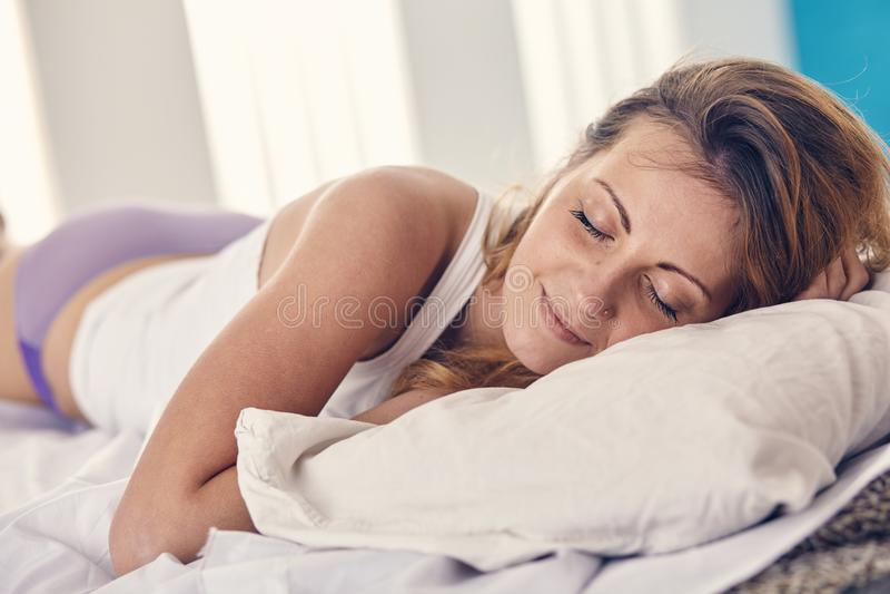 Woman has a good morning sleep. Beautiful woman has a good morning sleep stock photo