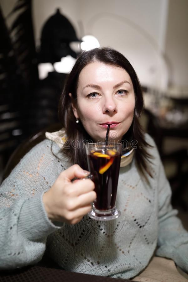Woman has mulled wine stock photos