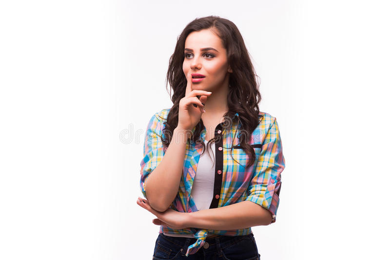 Woman has put forefinger to lips as sign of silence stock image