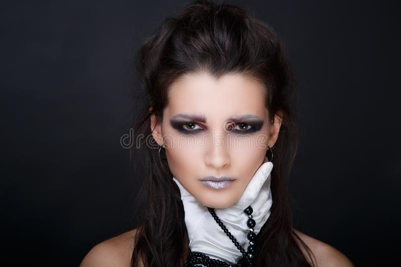 Woman has a sore throat. Sad woman face expression, girl lady female has a sore throat, hand in the white silk glove squeezes her neck. Bright colors makeup, lip stock image