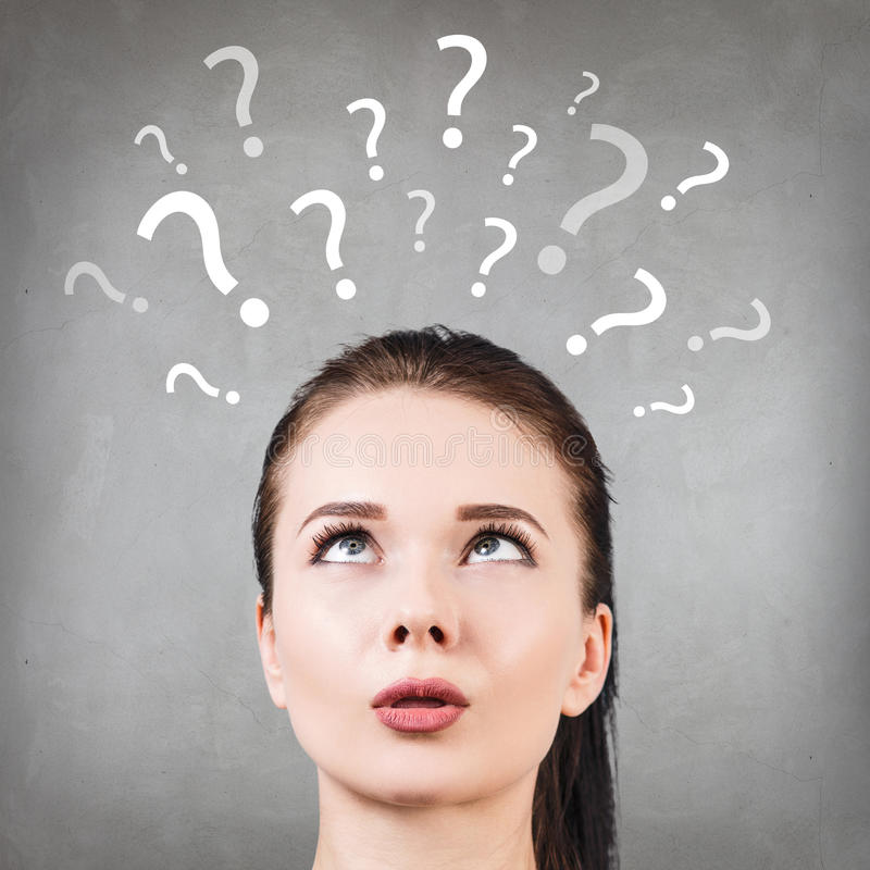 Woman has too many questions. Thoughtful confused beautiful woman has too many questions and no answer royalty free stock photos