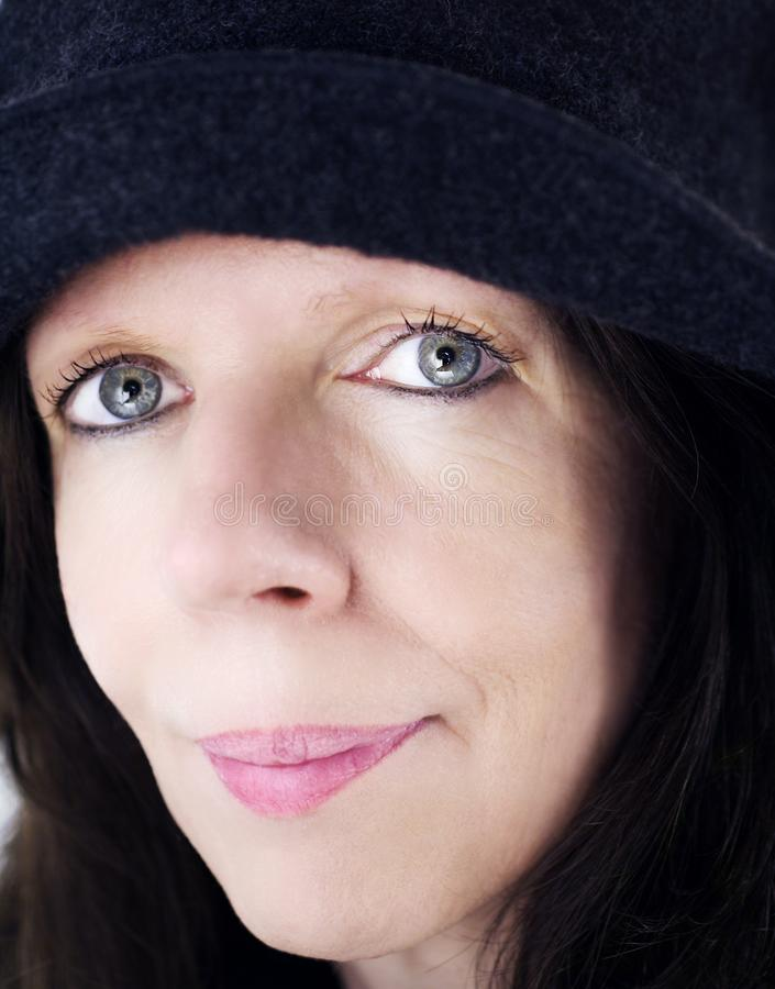 Woman with hat 2 royalty free stock photography
