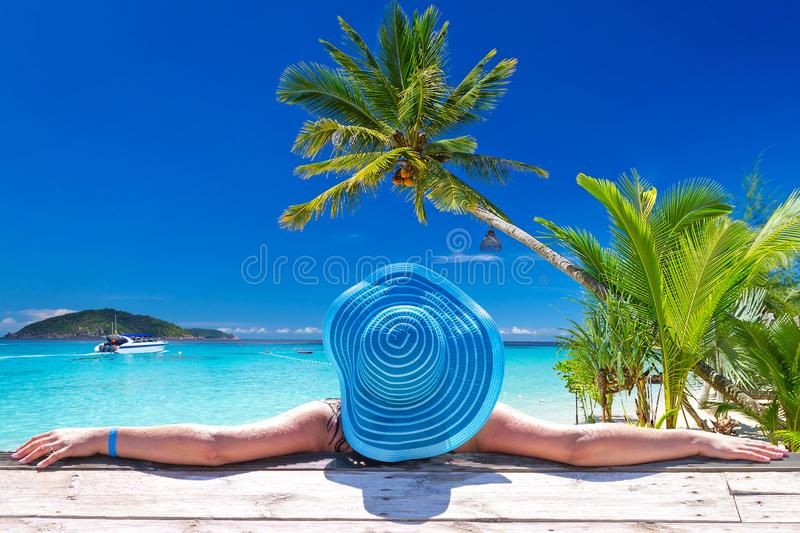 Woman in hat at beautiful Caribbean sea, Mexico. Beach, travel, resort, sunny, person, recreation, exotic, sunbath, tropics, dominican, lovely, destination stock photo