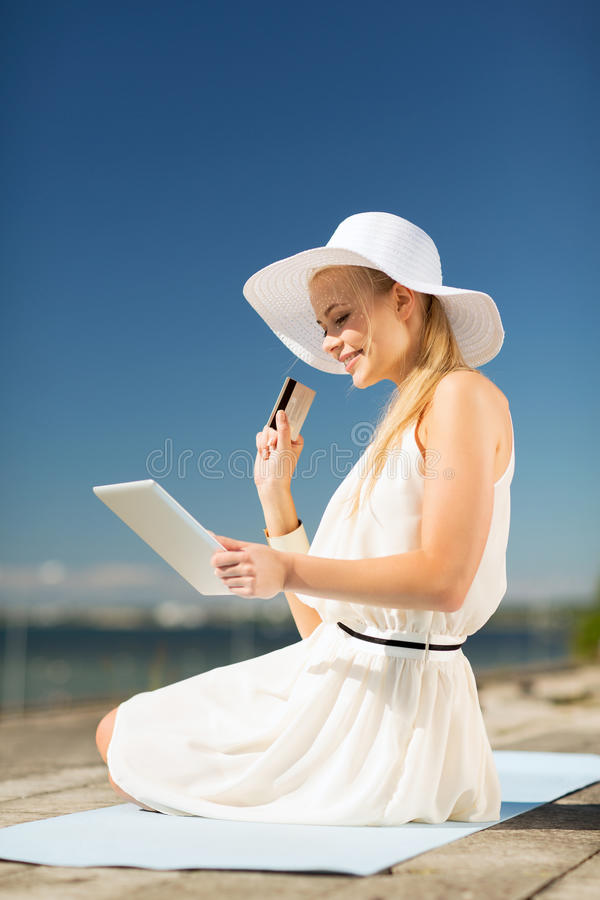 Download Woman In Hat Doing Online Shopping Outdoors Stock Image - Image: 33079663
