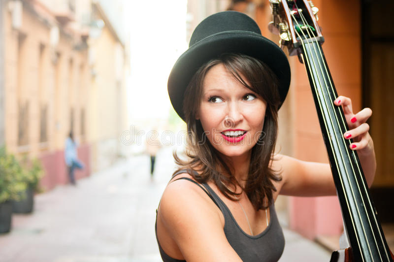 Download Woman In Hat Playing Double Bass On The Street Stock Images - Image: 31363544
