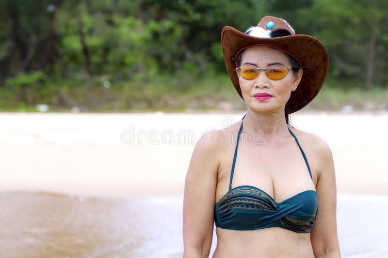 Woman and hat portriat outdoor on beach stock photography