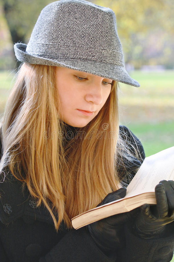 Download Woman In Hat Reading Royalty Free Stock Photo - Image: 11369655