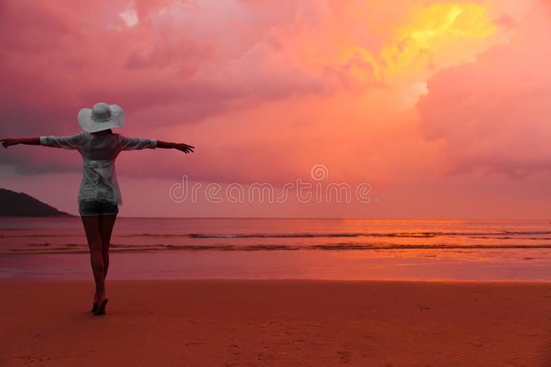 Download Woman In Hat Standing On Wet Sand On Beach Stock Photo - Image: 22230344