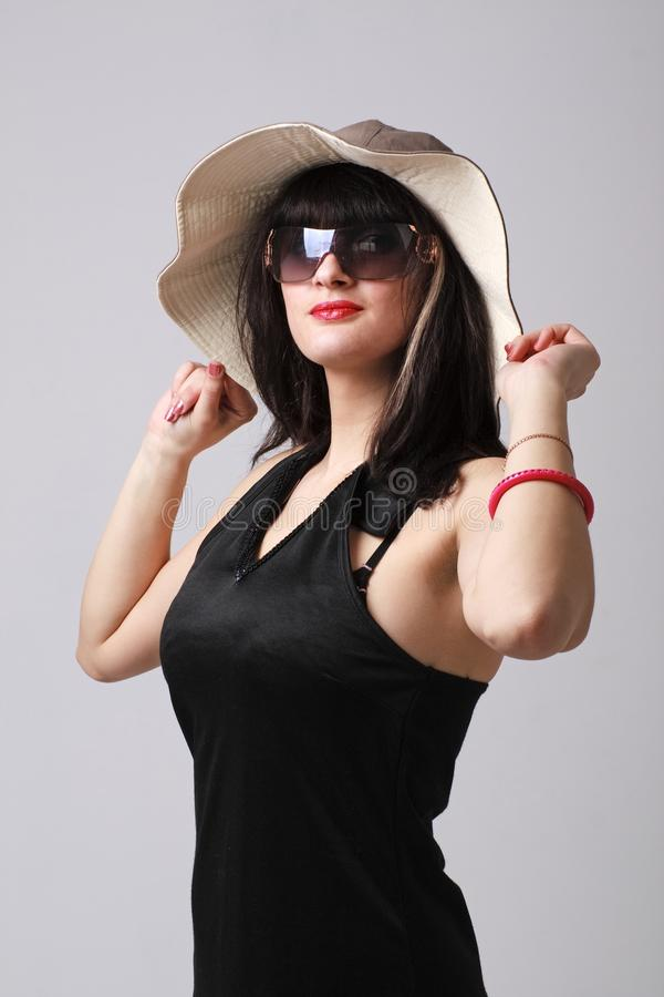 Woman with hat and sunglasses stock photography