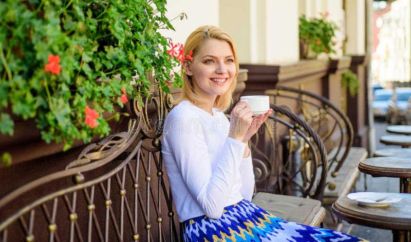 Woman have drink cafe terrace outdoors. Have sip of hot aromatic beverage. Mug of good coffee in morning gives me energy. Charge. Girl drink coffee every royalty free stock photography