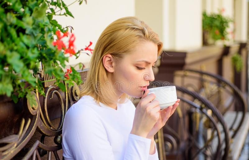Woman have drink cafe terrace outdoors. Mug of good coffee in morning gives me energy charge. Girl drink coffee every. Morning at same place as daily ritual stock image