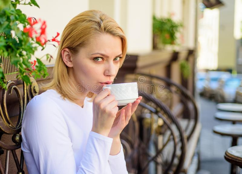 Woman have drink cafe terrace outdoors. Mug of good coffee in morning gives me energy charge. Girl drink coffee every. Morning at same place as daily ritual royalty free stock image
