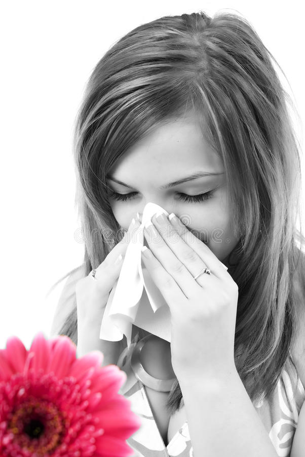 Woman having allergy from spring flowers royalty free stock photos