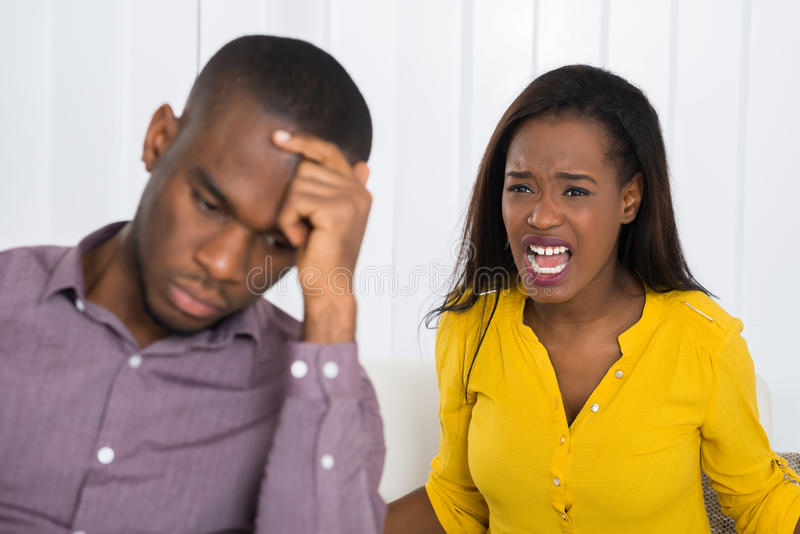 Woman Having Argument With Man. Unhappy Young Woman Having Argument With Man At Home stock photos