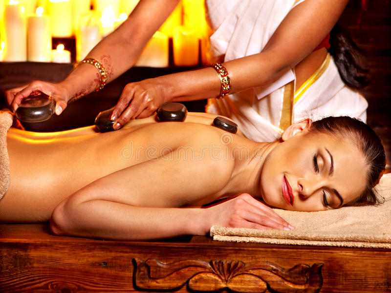 Woman having Ayurvedic stone massage. royalty free stock photography