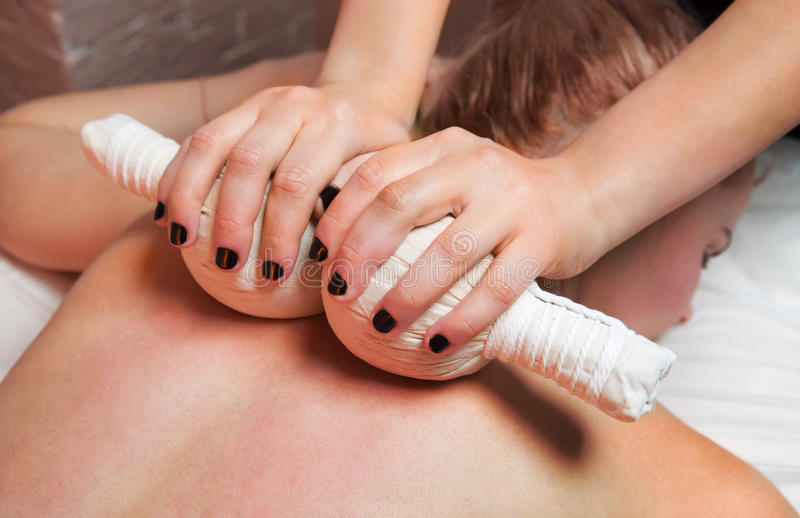 Woman having back massage royalty free stock photos
