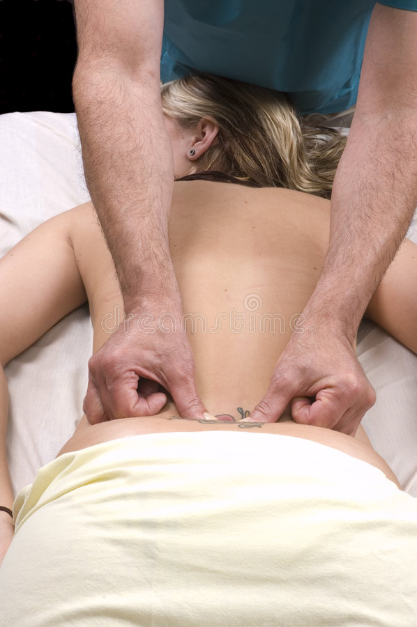 Download Woman Having Back Massage From Masseur Stock Photos - Image: 6059323