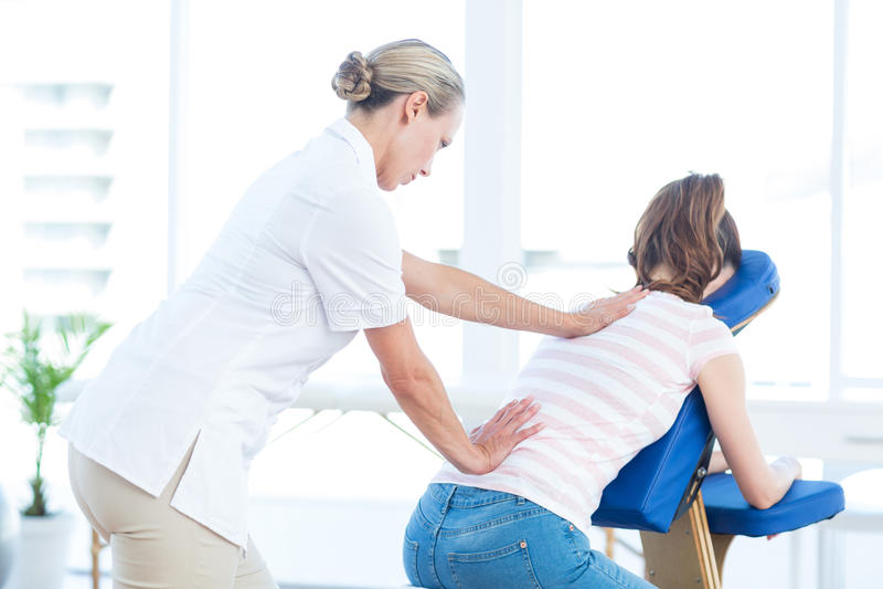 Woman having back massage royalty free stock images