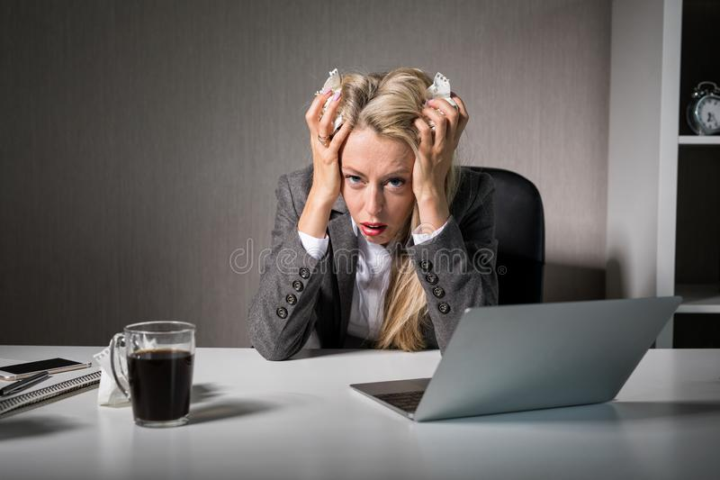 Woman having bad day at office. Business woman having bad day at office royalty free stock images
