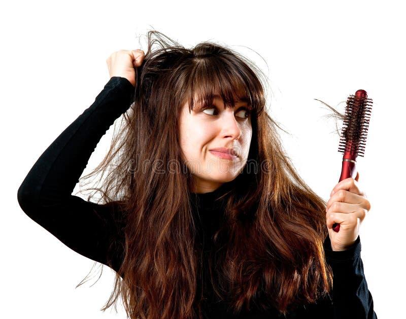 Woman having a bad hair day royalty free stock image