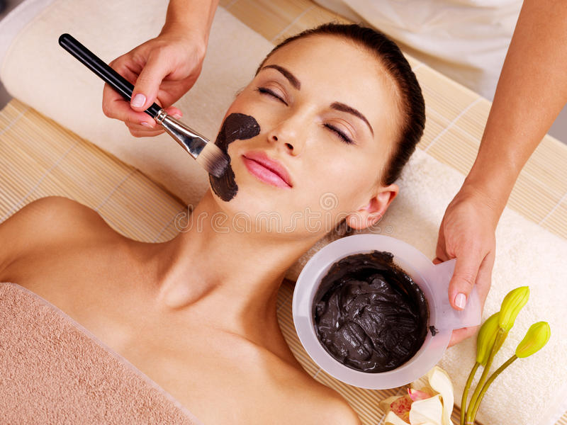 Woman having beauty treatments in the spa salon stock image