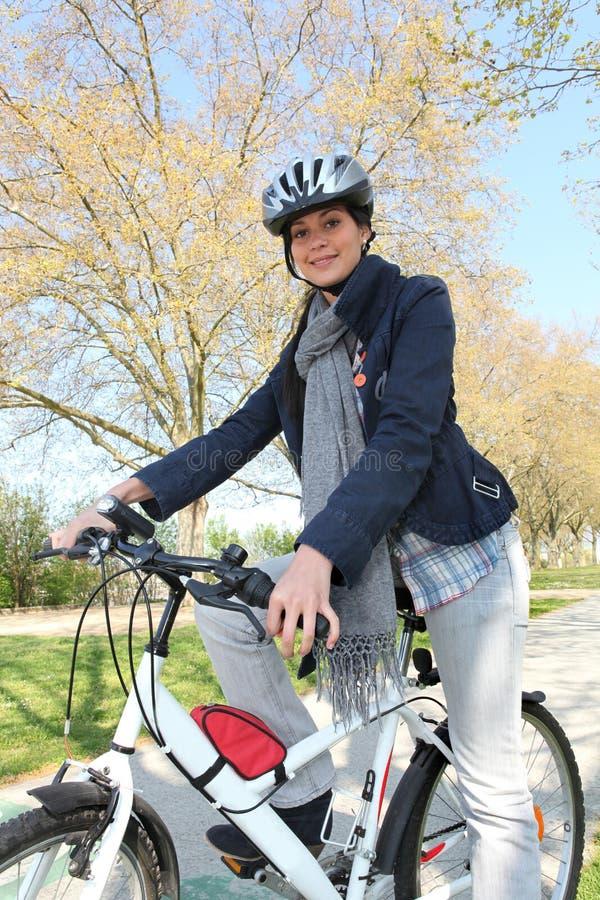 Woman having bike ride stock images