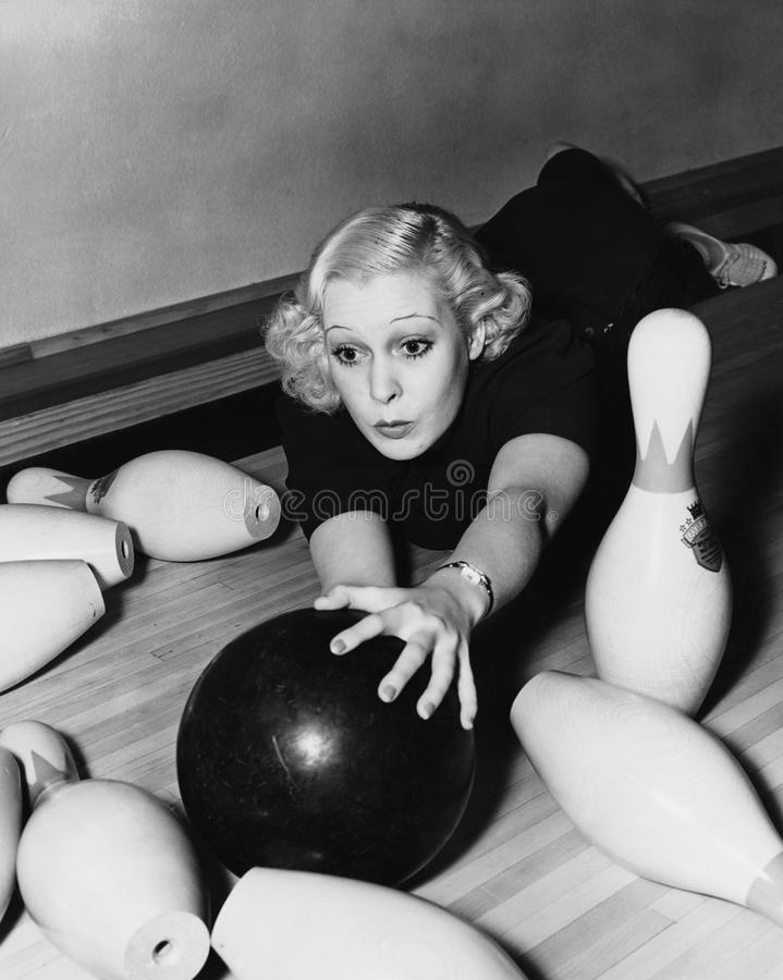 Woman having bowling accident stock photography