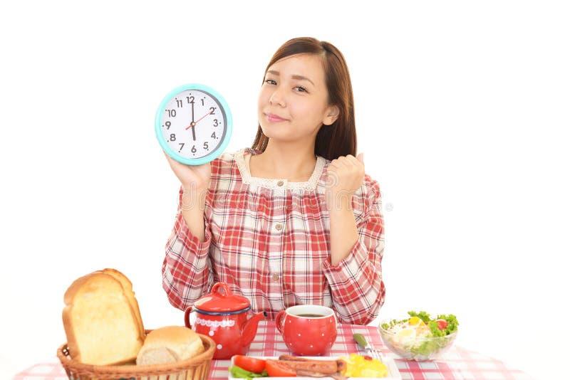 Woman having breakfast. Beautiful woman having breakfast at home stock images