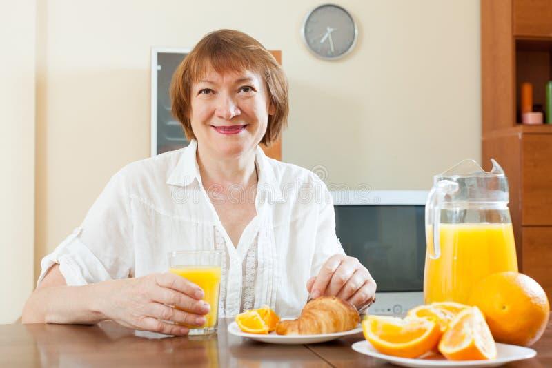 Download Woman Having Breakfast With Juice Stock Image - Image: 33544043