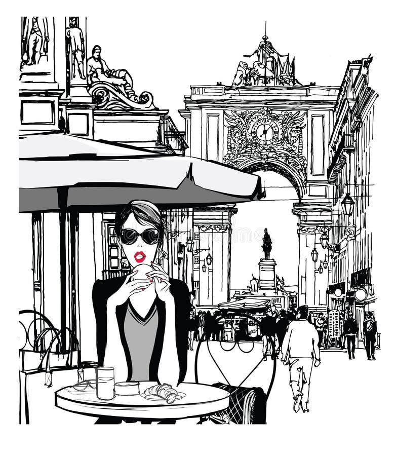 Woman having breakfast in the street of Lisbon royalty free stock photo