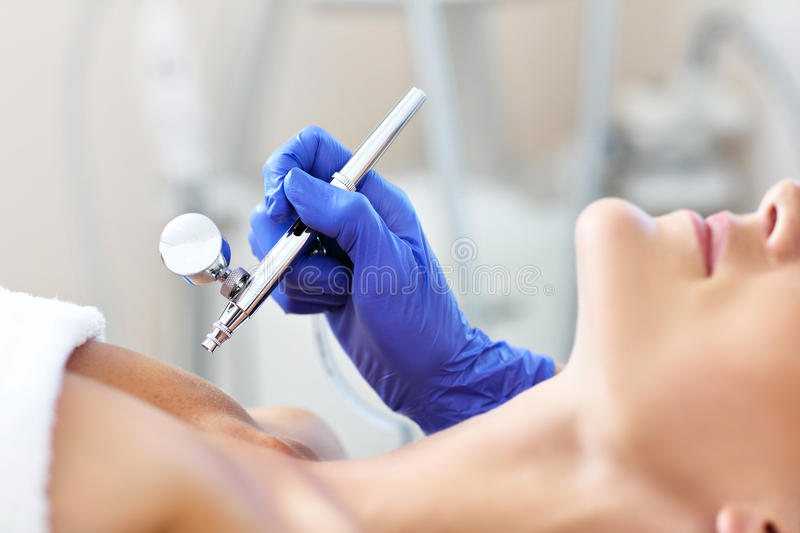 Woman having cleavage treatment in beauty salon. Picture of woman having cleavage treatment in beauty salon stock photography