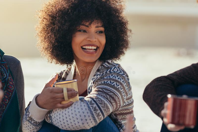 Woman having coffee with friends at the beach stock images